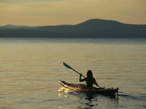 skip-brown-woman-kayaking-on-sebago-lake