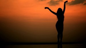 stock-footage-silhouette-of-the-woman-at-sunset