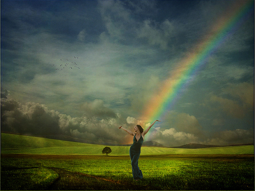 woman_in_field_with_rainbow_for_tu_bav_blog_8-7-12_via_flickr_by_maraearth_light_cc